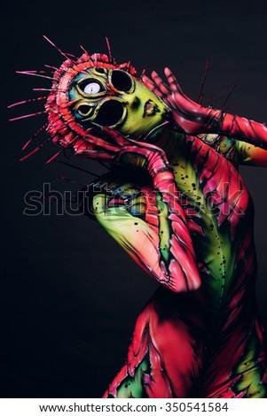 Woman wearing freak costume and mask