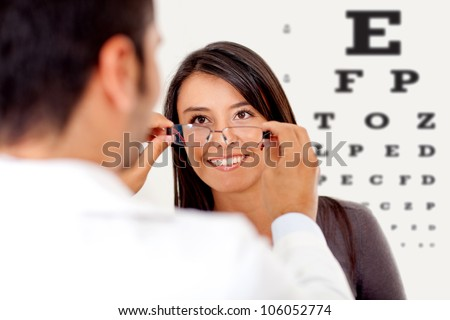 Woman wearing glasses after taking a vision test at the doctor