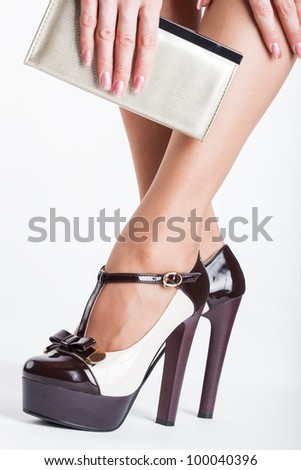 Woman wearing high heels on white background