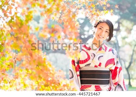 woman wearing japanese traditional kimono in autumn #445721467