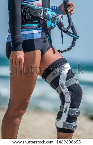woman wearing knee brace for LIA ligaments injuries, meniscus and instability Recovery after Anterior knee ligament surgery or preventing injuries using professional knee brace   Foto stock ©