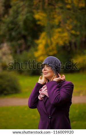 woman wearing retro felt hat and wool coat . Outdoor, Handicraft.