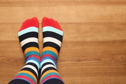 Woman wearing stylish socks standing on floor, top view. Space for design