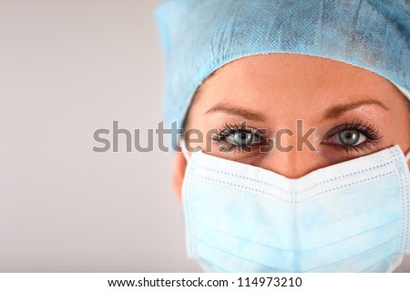 Woman wearing surgical mask - stock photo
