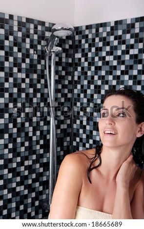 Woman wearing towel in shower