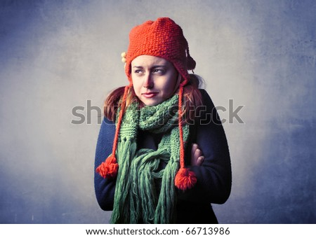 Woman wearing winter clothes feeling cold