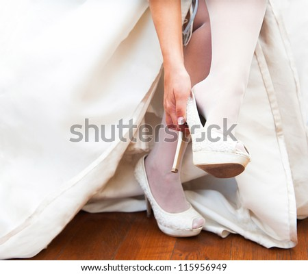 woman wears a wedding shoes with heels #115956949