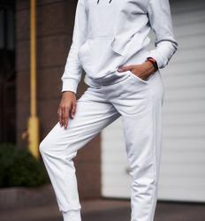 woman wears white pants. sport girl is wearing light trousers