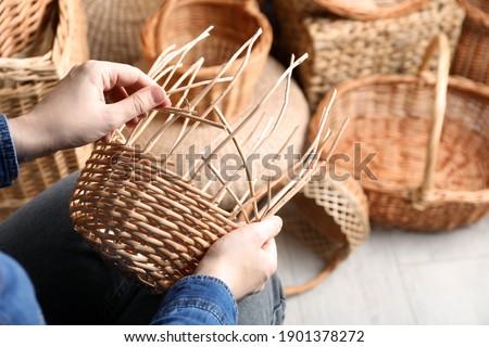 Woman weaving wicker basket indoors, closeup view Stock foto ©