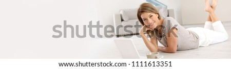 Woman websurfing on the net with laptop, template