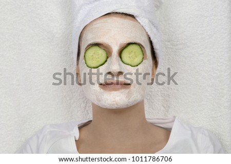 Woman wellness with cucumber skin face mask