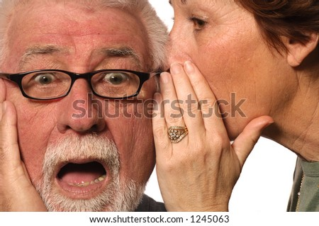 Woman whispers a scary secret into husband's ear