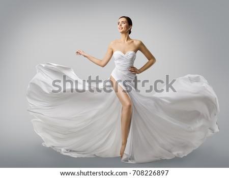 Woman White Dress, Fashion Model Bride in Long Silk Wedding Gown, Elegant Flying Fabric, Fluttering Cloth #708226897