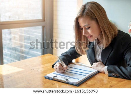 Woman who are filling application form.
