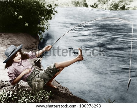 Woman who caught a small fish falling over backwards