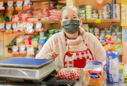 Woman who owns a small neighborhood store