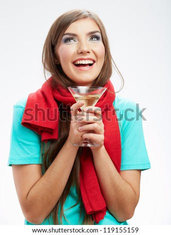 Woman winter style clothes portrait. Smiling model with alcohol drink isolated on white background