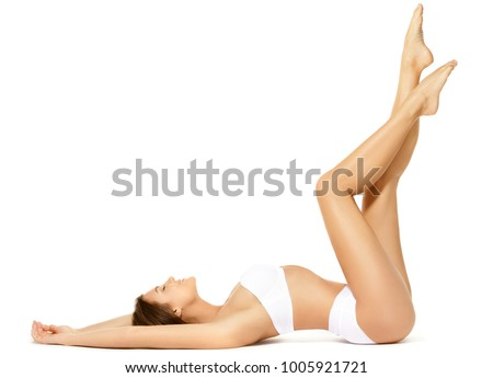 Woman with a beautiful long legs isolated on white background