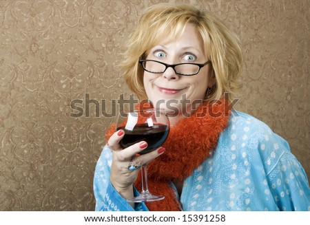 Woman with a big grin drinking red wine