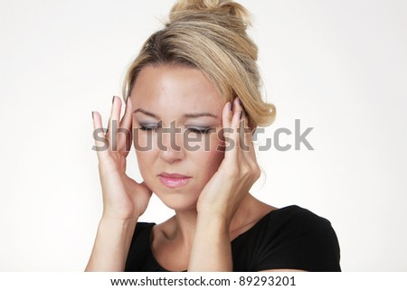 woman with a big headache shot in the studio