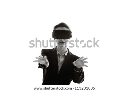 woman with a blind fold on so she can not see where she is going - stock photo