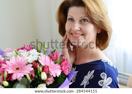 Woman with a bouquet of a flowers in the room #284544155