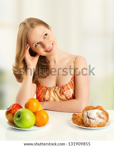 woman with a buns and fruits choose between healthy and unhealthy food