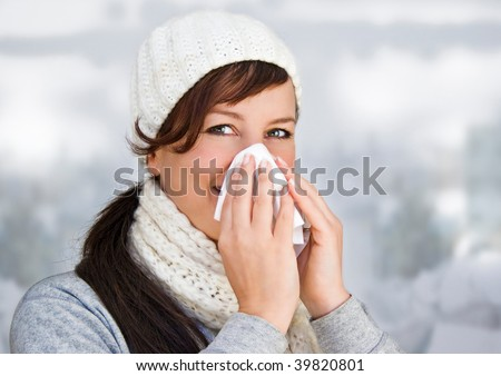 woman with a cold holding a tissue (without snow in background)
