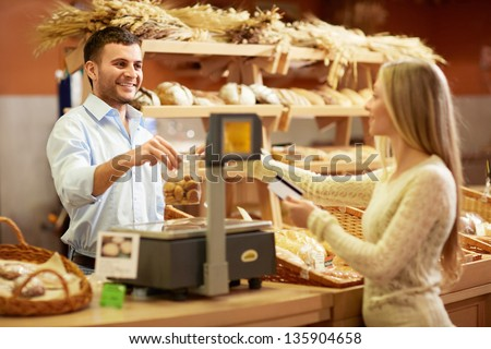 Woman with a credit card at the counter