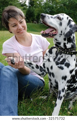 woman  with a Dalmatian outdoors
