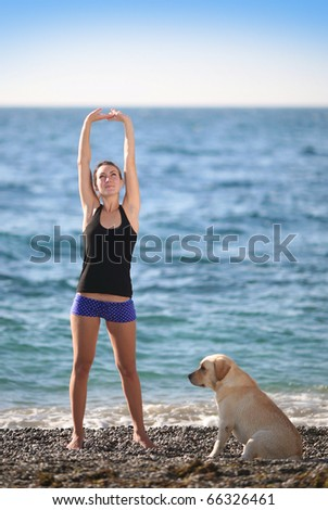 woman with a dog at sea