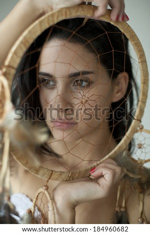 woman with a dream catcher , girl in traditional Indian wear and dream catcher posing to the camera ,