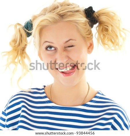 Woman with a funny look on her face smiles over a white background.