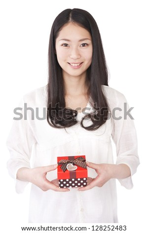 Woman with a gift box - stock photo