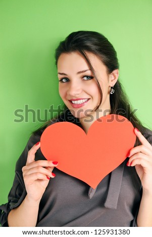 woman with a heart on a green background