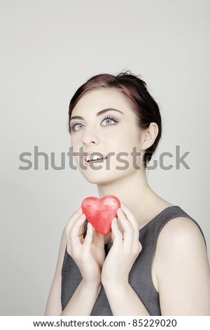 woman with a love heart shaped symbol to give to you