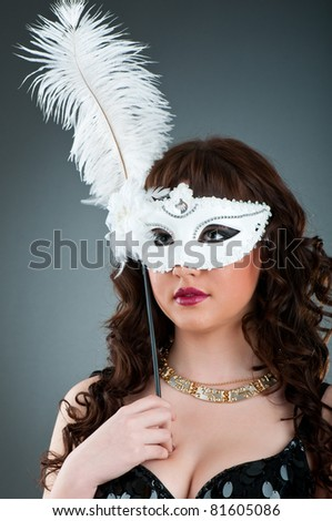 Woman with a mask in studio shooting