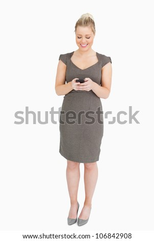 Woman with a phone in her hands against white background