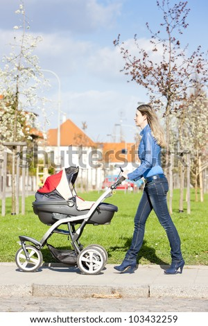 woman with a pram on walk