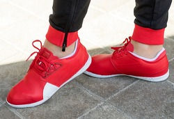 Woman with a red running shoes close up