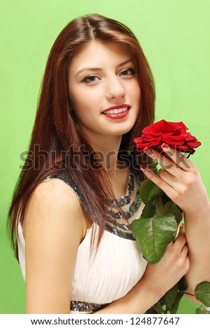 Woman with a rose on a green background