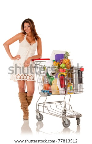 Woman with a shopping cart buying groceries - isolated over white
