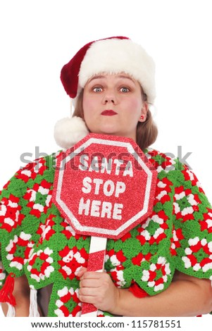 Woman with a sign Santa Stop Here