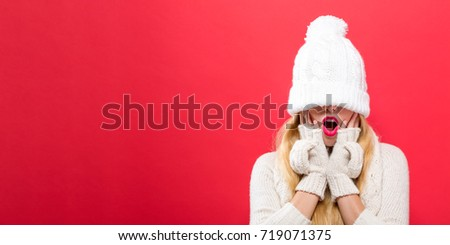 Woman with a winter knit hat pulled over her eyes #719071375