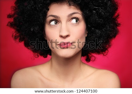Woman with afro wig looking to the side