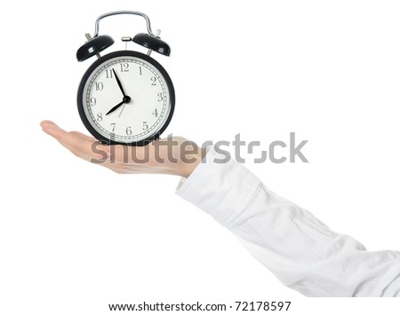 woman with an alarm clock in a hand. Isolated on white background