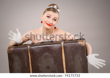 woman with an old suitcase