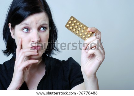 woman with anti-baby pill