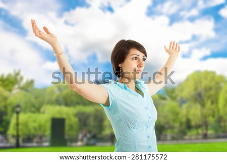 Woman with arms open enjoying the sun