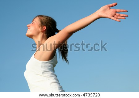 Woman with arms wide open
